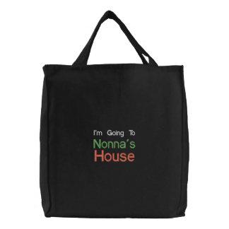 Ir bordado preto ao saco da casa de Nonnas Bolsas