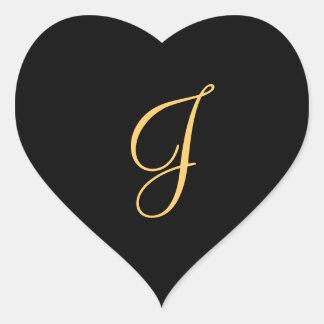 j inicial Ouro-colorido na etiqueta preta do
