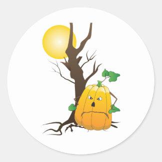 Jack o'lantern com árvore seca e uma lua adesivo