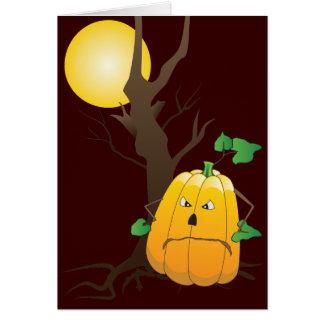 Jack o'lantern com árvore seca e uma lua