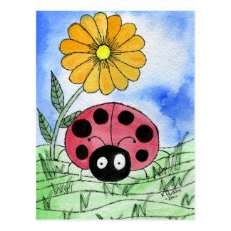 Joaninha com flor cartões postais