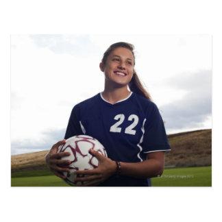 jogador de futebol adolescente da menina que cartão postal