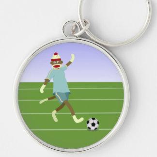 Jogador de futebol do macaco da peúga chaveiro redondo na cor prata