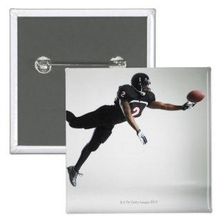 Jogador de futebol que pula no meio do ar para tra bóton quadrado 5.08cm