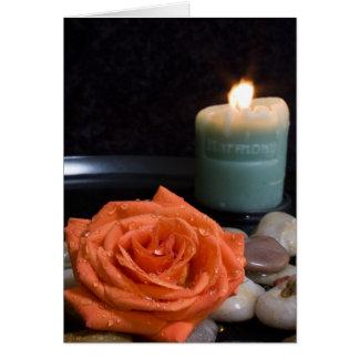 Laranja cor-de-rosa e vela da harmonia cartão