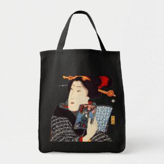 Leitura japonesa da mulher sacola tote de mercado