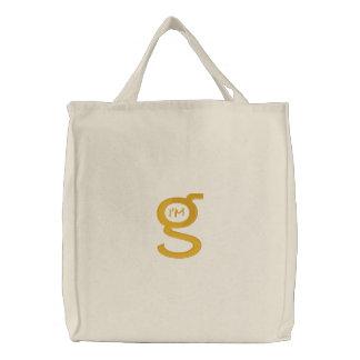 Logotipo bordado do ouro de w da bolsa