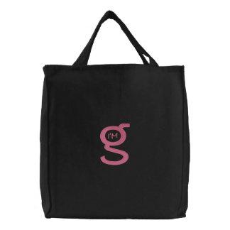 Logotipo cor-de-rosa bordado de w da bolsa