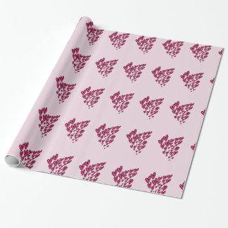 Lotes de corações cor-de-rosa no fundo cor-de-rosa papel de presente