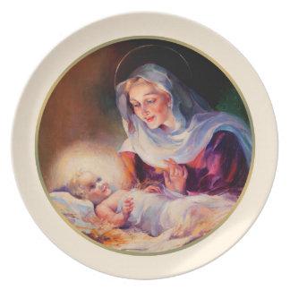 Madonna e criança. Placas do presente do Natal das Prato
