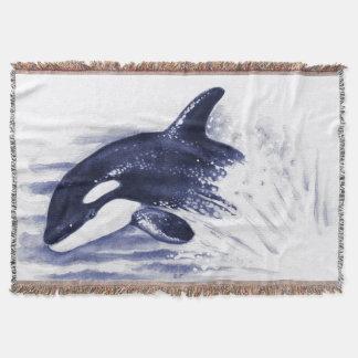 Manta Orca que rompe o azul