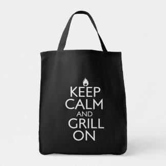 Mantenha a calma e a grade sobre bolsas para compras