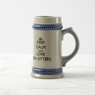 Mantenha a calma e ame lontras de mar caneca de cerveja