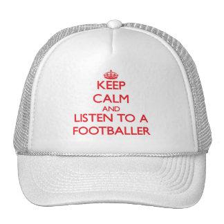 Mantenha a calma e escute um jogador de futebol boné