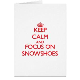 Mantenha a calma e o foco em sapatos de neve cartão comemorativo