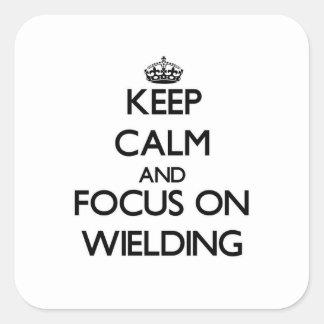 Mantenha a calma e o foco em Wielding Adesivo Quadrado