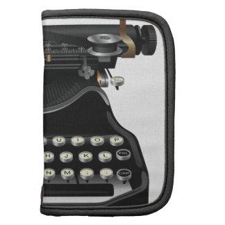 Máquina de escrever antiga organizadores