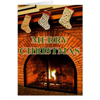 meias do Natal e cartão da lareira