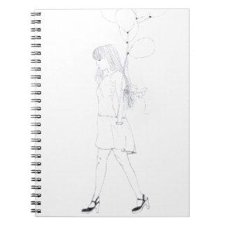 Menina com caderno dos balões