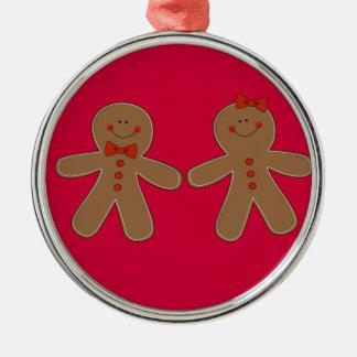 Menino e menina do pão-de-espécie ornamento redondo cor prata