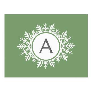 Monograma branco ornamentado do floco de neve no v cartões postais