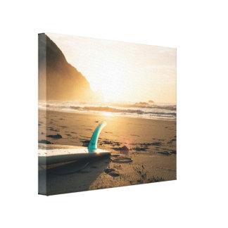 Nascer do sol na areia da praia impressão em tela