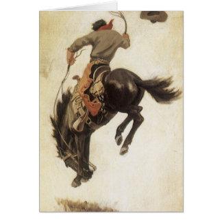 Natal vintage, vaqueiro no cavalo Bucking do Cartão Comemorativo
