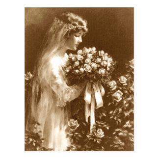 Noiva bonita com um buquê do rosa cartão postal