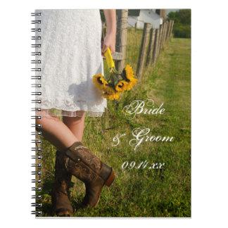Noiva, botas de vaqueiro e casamento do rancho dos caderno espiral