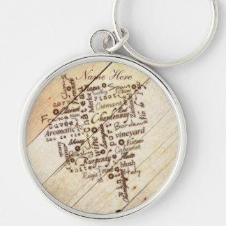 Nome de madeira queimado rústico da tipografia do chaveiro redondo na cor prata