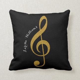 nota musical de clef de triplo com seus ouro & almofada
