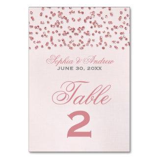 Número cor-de-rosa da mesa do casamento dos confet