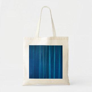 O azul drapeja bolsas para compras