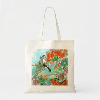 O bolsa bonito das flores do colibri e da laranja