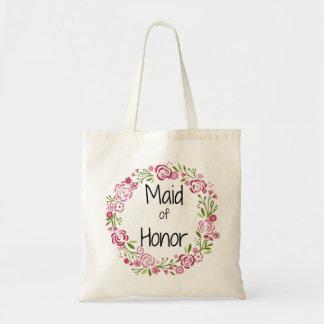 O bolsa floral bonito da madrinha de casamento