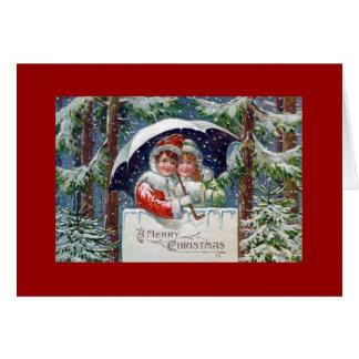 O cartão do feriado do vintage do Feliz Natal caço
