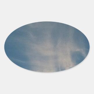 O céu azul de queda drapeja adesivo oval