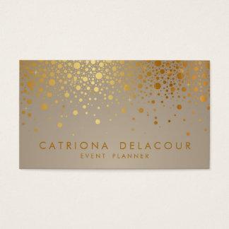 O confete da folha de ouro do falso pontilha o cartão de visitas