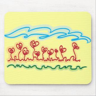 o coração dado forma floresce o mousepad