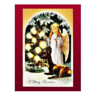 O cumprimento do Natal com um anjo decora o chr Cartão Postal