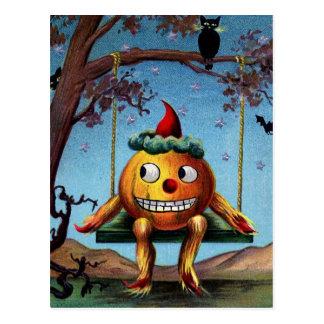 O Dia das Bruxas feliz da abóbora em um balanço Cartão Postal