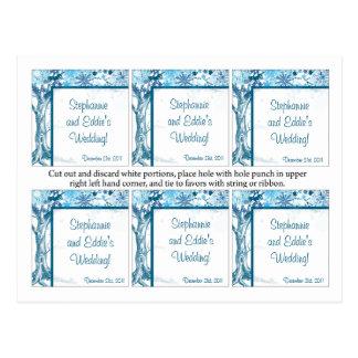 O favor etiqueta a árvore/flocos de neve azuis cartão postal
