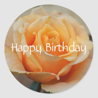 O feliz aniversario, aumentou no pêssego adesivo