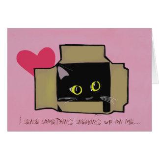 O gato preto cai no cartão do amor