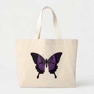 O grande bolsa roxo da borboleta