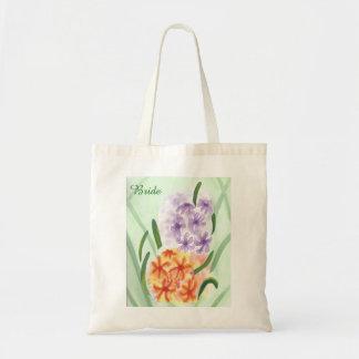 O jacinto alaranjado roxo floresce as bolsas da bolsa tote
