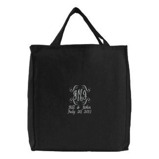 O monograma do casamento nomeia o saco do preto do bolsas