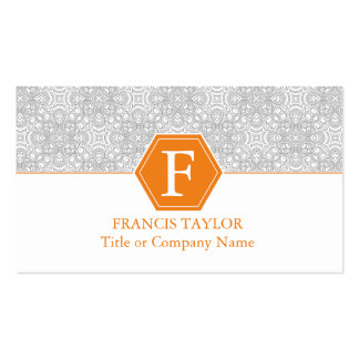 O monograma retro elegante das cinzas e da laranja