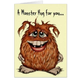 O monstro bonito abraça o cartão