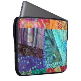 O olhar acolchoado do Batik colorido esquadra a Capa Para Laptop